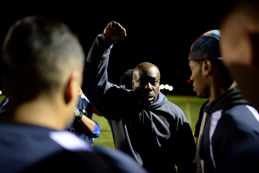 The 52nd Communications Squadron football team coach, motivates his team during the intramural football championship game at Spangdahlem Air Base, Germany, Nov. 10, 2014. The 52nd CS won 15 out of 19 games for the season. (U.S. Air Force photo by Staff Sgt. Daryl Knee/Released)