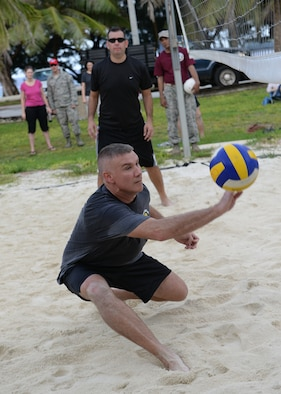Maj. Ralph Piper II, 36th Logistic Readiness Squadron commander, saves a ball during a commanders vs. first sergeants beach volleyball game Nov. 7, 2014, at Tarague Beach at Andersen Air Force Base, Guam. The morale boosting game was held in correlation with Bamboo Willies 'First Friday' event. (U.S. Air Force photo by Senior Airman Katrina M. Brisbin/Released)
