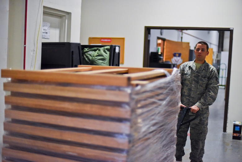 Tech. Sgt. Lee Olson transports new bed frames into a supply warehouse Oct. 20, 2014, at Malmstrom Air Force Base, Mont. Olson has personally ordered and distributed more than $400,000 worth of Force Improvement Program equipment to the base's missile complex. Olson is a 341st Operations Group supply coordinator. (U.S. Air Force photo/Airman 1st Class Collin Schmidt)