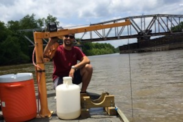 A Phinizy Center scientist collecting an integrated water sample on the Savannah River.
