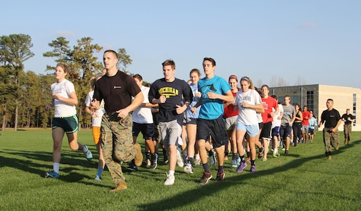 Capt. Zachary Smith leads athletes from Shawnee High School for a run during a leadership seminar at the high school in Medford, N.J., November 12, 2014.