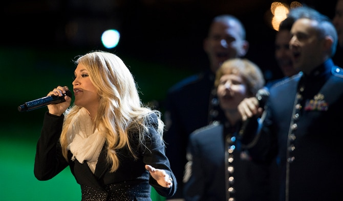 The Air Force Singing Sergeants sing chorus for Carrie Underwood Nov. 11, 2014, during The Concert for Valor in Washington, D.C. The Singing Sergeants are the Air Force's premier, 23-member active-duty chorale group. (DoD News photo/EJ Hersom)