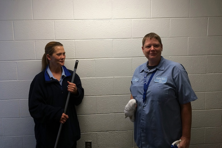 MCGHEE TYSON AIR NATIONAL GUARD BASE, Tenn. - A wasp in one of the laundry rooms causes a quick evacuation for housekeepers, from left, Michelle Chavis and Kerri Hurst. An Airman nearby came to their aid and got rid of the pest using his hat here Nov. 7, 2014, at the McGhee Tyson Inn. (U.S. Air National Guard photo by Master Sgt. Mike R. Smith/Released)