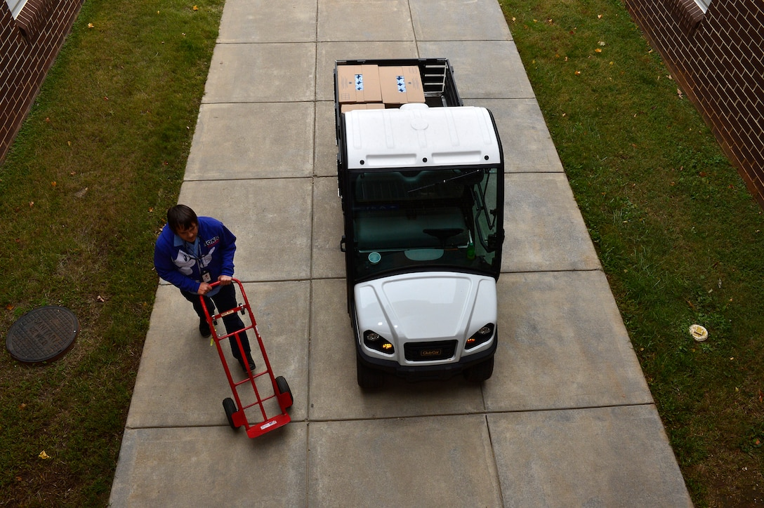 MCGHEE TYSON AIR NATIONAL GUARD BASE, Tenn. - Micheal Petak drives cleaning supplies across campus to one of four billeting buildings and handcarts them up and down to the various floors here Nov. 7, 2014, at the McGhee Tyson Inn. (U.S. Air National Guard photo by Master Sgt. Mike R. Smith/Released)