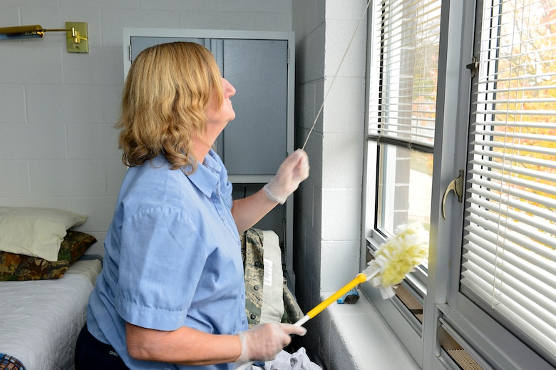 MCGHEE TYSON AIR NATIONAL GUARD BASE, Tenn. - Dusting a room, here Nov. 7, 2014, at the McGhee Tyson Inn, Melody Curtis goes about housekeeping for an I.G. Brown Training and Education Center student. (U.S. Air National Guard photo by Master Sgt. Mike R. Smith/Released)