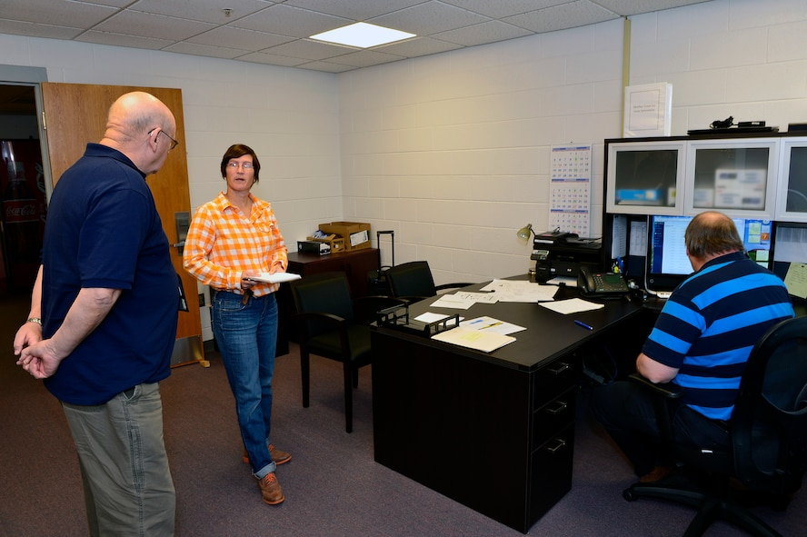 MCGHEE TYSON AIR NATIONAL GUARD BASE, Tenn. - Discussing morning operations, from left: Randy Fisher, Abby Aberdeen, billeting manager, and Jim Collins here Nov. 7, 2014, at the McGhee Tyson Inn. The Inn's staff includes more than two dozen state and contract employees who work three shifts. Each morning housekeepers assigned to the four, multilevel buildings, begin a daunting task to check and prepare more than 243 rooms with 393 beds. They navigate their cleaning supplies, carts and vacuums through a maze of hallways, breezeways, lounges and laundry rooms. (U.S. Air National Guard photo by Master Sgt. Mike R. Smith/Released)