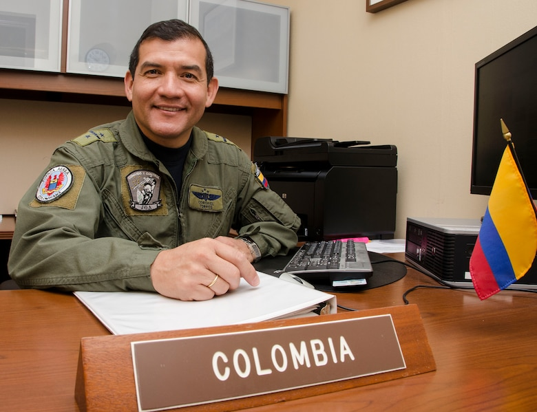 Colonel Carlos Torres, Air Forces Southern Colombian Liaison Officer, smiles before preparing to execute his daily duties as LNO at Davis-Monthan AFB, Ariz., Nov. 5, 2014. Torres has been following in his father's footsteps and began his Colombian air force career in 1987 and now, as the Colombian air force's liaison officer for Air Forces Southern, he hopes to raise awareness of the important changes his country has made to become a regional leader in South America. (U.S. Air Force photo by Staff Sgt. Adam Grant/Released)