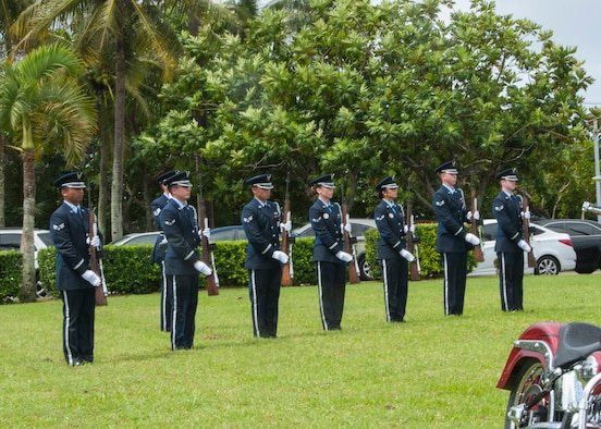 Members of the Andersen Air Force Base Blue Knights honor guard team prepare to give a 21-gun salute at the 2014 Guam Veterans Day ceremony at the Governors complex in Hagåtña, Guam Nov. 11, 2014. More than 200 people showed up to the ceremony to honor all military veterans including Staff Sgt. Maximilian Contreras, 36th Operation Support Squadron weather flight, who represented Andersen as the Air Force Veteran of the Year. (U.S. Navy photo by Leah Eclavea/Released)