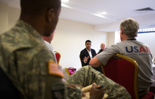 In Monrovia, Liberia, U.S. Agency for International Development Administrator Rajiv Shah meets with members of the USAID Disaster Assistance Response Team, members of the Centers for Disease Control and Prevention, and U.S. military officers about the Ebola response in Liberia, Oct. 14, 2014. USAID photo by Morgana Wingard