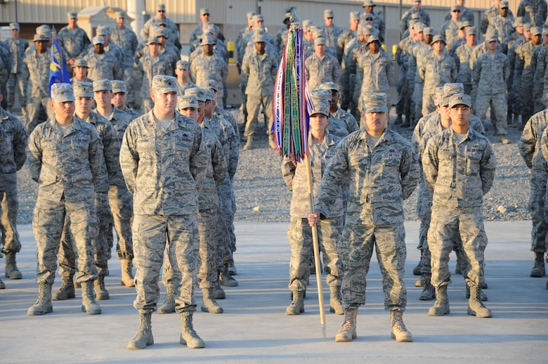 The 386th Air Expeditionary Wing Honor Guard lowers the flag during a Veteran's Day retreat ceremony here Nov. 11, 2014. The Air Force Sergeants Association Satellite Chapter 1674 sponsored the ceremony as its inaugural event here. (U.S. Air Force photo by Master Sgt. Eric Petosky/released