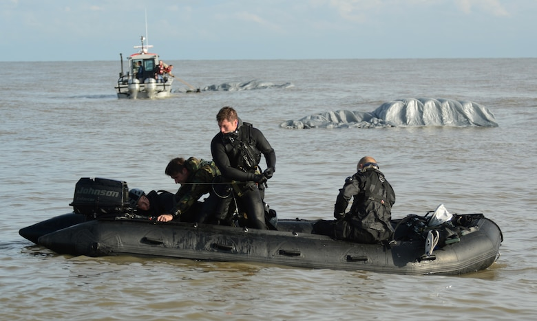 Special operations Airmen from the 321st Special Tactics Squadron and the 56th Rescue Squadron load a zodiac boat with gear that was dropped from the MC-130J Commando II into the water Nov. 4, 2014, off the coastline of Ipswich, England. The Airmen conducted amphibious special operations procedures throughout the week. The 321st STS is based at Royal Air Force Mildenhall, and the 56th RS operates out of RAF Lakenheath, England. (U.S. Air Force photo/Airman 1st Class Dillon Johnston)