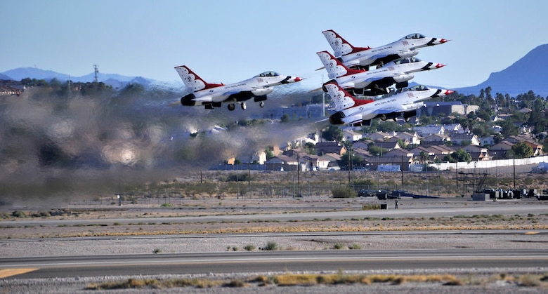The U.S. Air Force Thunderbirds aerial demonstration team takes off for their performance Nov. 8, 2014, during an open house event at Nellis Air Force Base, Nev. The two-day open house featured performances from legacy aircraft such as the P-51 Mustang, and modern aircraft such as the F-22 Raptor. (U.S. Air Force photo/Airman 1st Class Christian Clausen)
