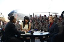"Airmen with the 108th Wing attend a special live broadcast of ESPN's ""First Take"" hosted by Stephen A. Smith, Skip Bayless and Cari Champion, Nov. 10, 2014, at Joint Base McGuire-Dix-Lakehurst, N.J. The ""Salute the Troops"" broadcast in honor of Veterans Day was set with a backdrop of a KC-10 Extender and KC-135 Stratotanker, and various other military vehicles. (U.S. Air National Guard photo/Tech. Sgt. Carl Clegg)"