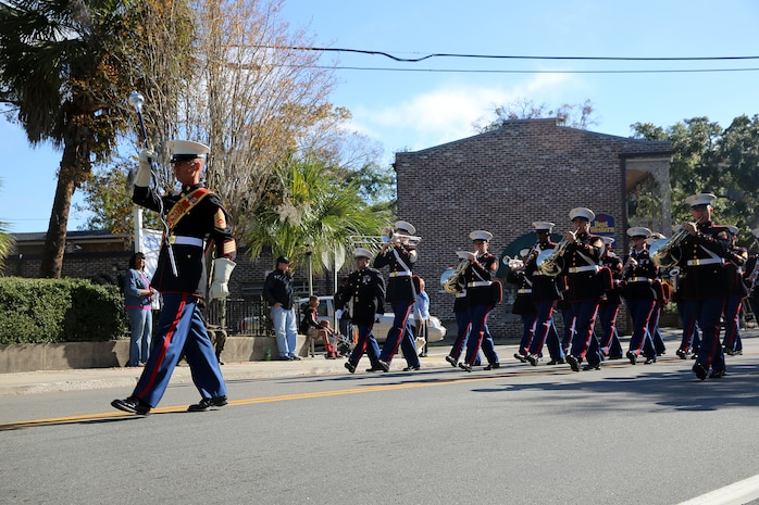 Tri-Command service members participated in the Veterans Day Parade and Ceremony at the Beaufort National Cemetery in Beaufort, Nov. 11.The annual event is held to recognize Beaufort's veterans and active duty service members. During the parade, the streets were lined with people waving American flags and cheering as the color guard, the Parris Island Marine Band, veterans and active duty service members and local organizations paraded through the streets. Following the parade, approximately 200 people were in attendance for the ceremony, including veterans and active duty service members of every branch of service.