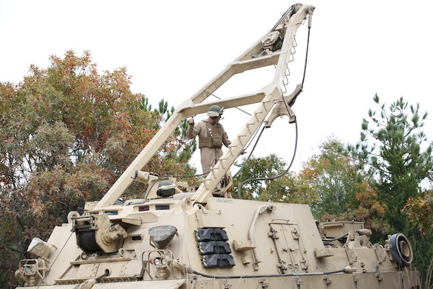 Marines with Tank Platoon, Company B, Ground Combat Element Integrated Task Force, operate an M88 recovery vehicle during a field exercise at Landing Zone Hawk aboard Marine Corps Base Camp Lejeune, North Carolina, Nov. 13, 2014. From October 2014 to July 2015, the GCEITF will conduct individual and collective level skills training in designated ground combat arms occupational specialties in order to facilitate the standards based assessment of the physical performance of Marines in a simulated operating environment performing specific ground combat arms tasks. (U.S. Marine Corps photo by Cpl. Paul S. Martinez/Released)