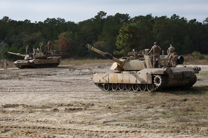 Marines with Tank Platoon, Company B, Ground Combat Element Integrated Task Force, stage M1A1 Abrams tanks at Landing Zone Hawk aboard Marine Corps Base Camp Lejeune, North Carolina, Nov. 13, 2014. From October 2014 to July 2015, the GCEITF will conduct individual and collective level skills training in designated ground combat arms occupational specialties in order to facilitate the standards based assessment of the physical performance of Marines in a simulated operating environment performing specific ground combat arms tasks. (U.S. Marine Corps photo by Cpl. Paul S. Martinez/Released)