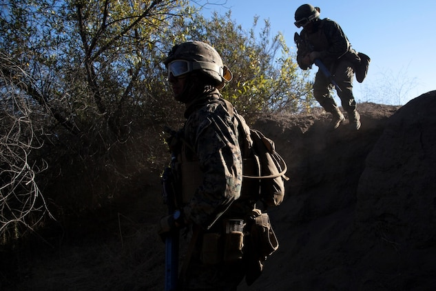U.S. Marines with 15th Marine Expeditionary Unit, move into position during a security element course aboard Camp Pendleton, Calif., Nov. 6, 2014. This three-week course is designed to improve the speed and accuracy of the Marines that will make up the maritime raid force's security element when the 15th MEU deploys in the spring. (U.S. Marine Corps photo by Cpl. Elize Mckelvey/Released)