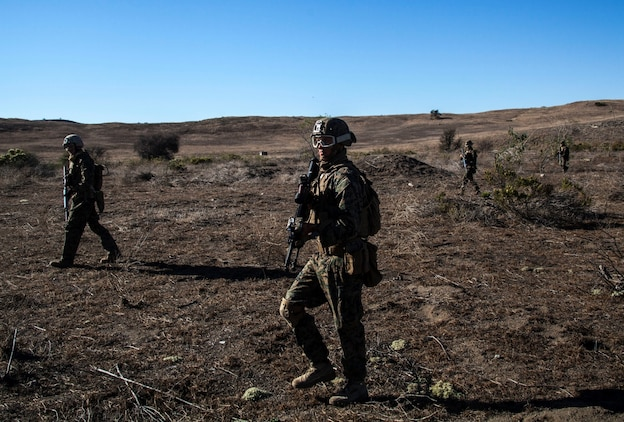 U.S. Marines with the 15th Marine Expeditionary Unit move into position during a security element course aboard Camp Pendleton, Calif., Nov. 6, 2014. This three-week course is designed to improve the speed and accuracy of the Marines that will make up the maritime raid force's security element when the 15th Marine Expeditionary Unit deploys in the spring. (U.S. Marine Corps photo by Cpl. Elize Mckelvey/Released)