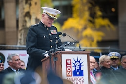 Guest of Honor Gen. John F. Kelly, Commander of U.S. Southern Command, speaks during the opening ceremony of New York City's annual Veterans Day Parade at Madison Square Park November 11, 2014. The parade, also known as America's Parade, highlights a different service each year. This year, the Marines were showcased for their legacy and traditions, which date back 239 years.