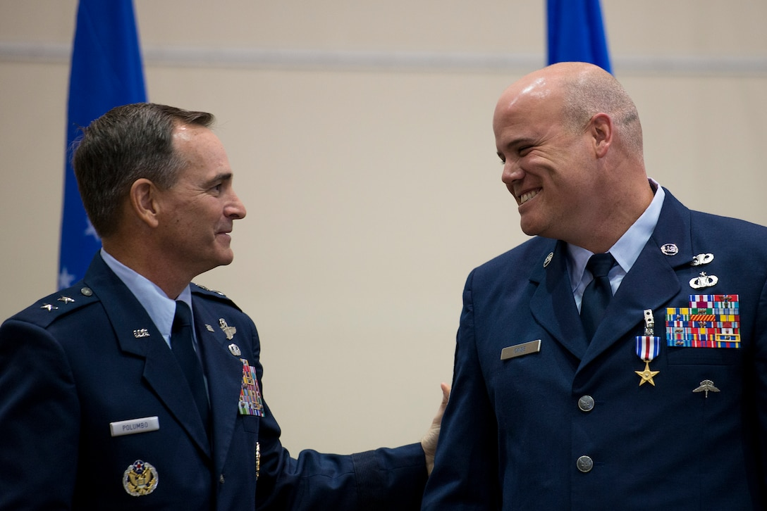 Maj. Gen. Harry Polumbo, Ninth Air Force Commander, presented Master Sgt. Thomas Case, Tactical Air Control Party Airman, 18th Air Support Operations Group, with his second Silver Star medal, Nov. 13, 2014 at Pope Army Airfield, N.C.  Case received the medal for gallantry in action during a 2009 deployment to Afghanistan. The Silver Star Medal is the U.S. military's third highest military decoration for valor. It is presented for gallantry in action against an enemy of the U.S. (U.S. Air Force photo by Airman 1st Class Ryan Callaghan)