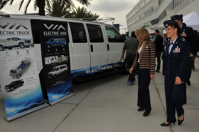 Miranda Ballentine greets vendors during the unveiling of the first federal facility to replace its entire general-purpose fleet with plug-in electric vehicles Nov. 14, 2014, at Los Angeles Air Force Base in El Segundo, Calif. The base's electric vehicle fleet, consisting of 42 vehicles, including sedans, pick-up trucks and mini vans, of which 36 will be vehicle-to-grid capable, is the largest operational V2G demonstration in the world.  Ballentine is the assistant secretary of the Air Force for installations, environment and energy. (U.S. Air Force photo/Sarah Corrice)