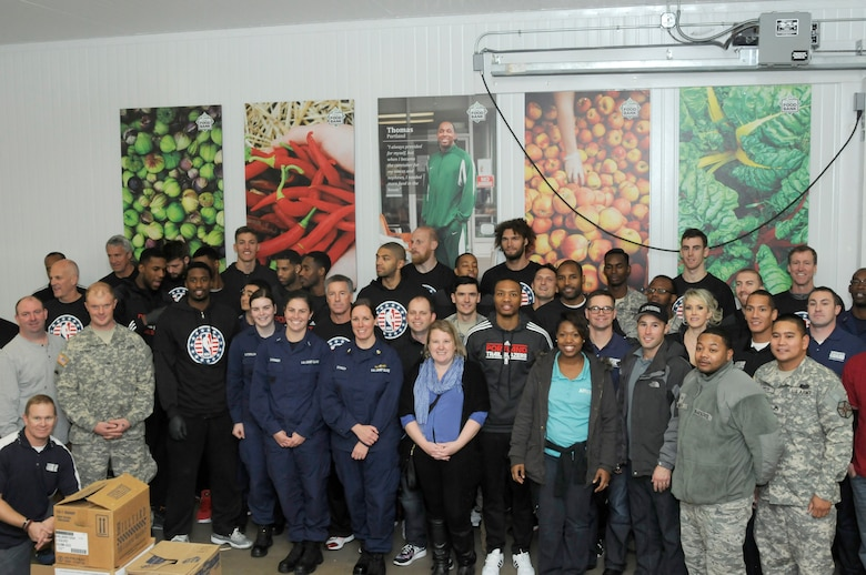 Military members from across Oregon and Washington teamed up with the Portland Trail Blazer players, managers and coaches to pack food boxes in support of the Oregon Food Bank today at the Food Bank's west-side location in Beaverton, Oregon. (U.S. Air National Guard photo by Capt. Angela Walz, 142nd Fighter Wing Public Affairs)