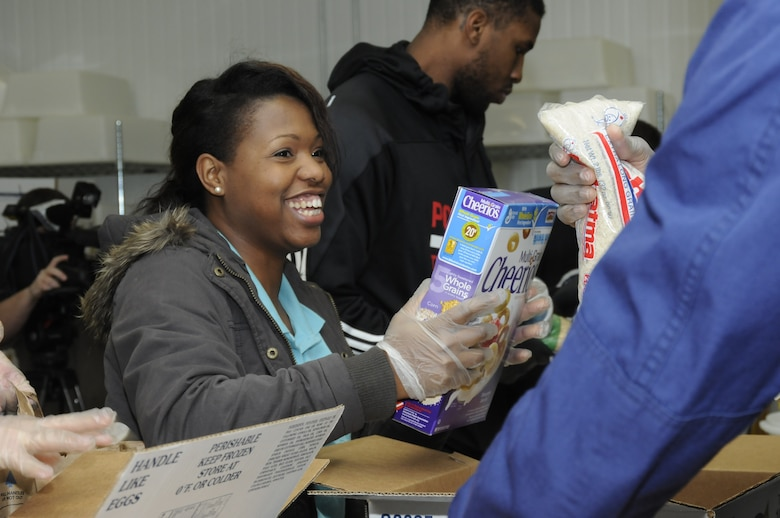 Master Sgt. Keela Tillery, a recruiter with Oregon National Guard Joint Force Headquarters who is stationed in Portland, packs food boxes with Portland Trail Blazer players, managers and coaches. The boxes will be distributed to families in need across the Food Bank's statewide network. (U.S. Air National Guard photo by Capt. Angela Walz, 142nd Fighter Wing Public Affairs)