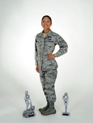 Tech. Sgt.  Dorothy Dingba, 67th Cyberspace Wing manpower analyst, poses with the trophies she won during the 34th annual Lackland Bodybuilding Classic, Nov. 8. (U.S. Air Force photo/ Senior Airman Lynsie Nichols)