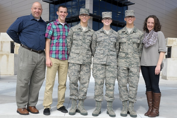 From left to right, Frankie, Frank, Brian, Brittany, Trevor and Wendy Petrine stand together in front of the Pfingston Reception Center Nov. 7 at Joint Base San Antonio-Lackland. Brian and Trevor are twins and graduated that day from basic military training with their younger sister Brittany.  