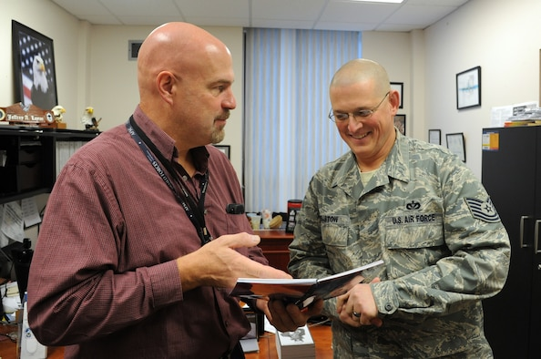 Jeffrey Leyrer, U.S. Air Force recovery care coordinator, discusses programs and benefits for service members with Tech. Sgt. Joshua Robistow, 319th Civil Engineer Squadron unit training manager, in the Medical Treatment Facility on Grand Forks Air Force Base, N.D., Nov. 12, 2014. Leyrer is tasked with ensuring service members who are wounded, seriously ill or become injured have access to the agencies they need to recover and return to duty. (U.S. Air Force photo/Staff Sgt. David Dobrydney)