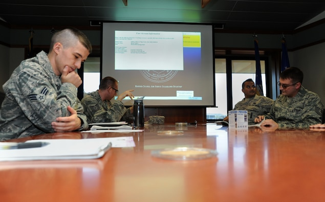 Senior Airman Miles Dodge, left, participates in the Junior Enlisted Council meeting taking place on Nov. 8, 2014, Portland Air National Guard Base, Ore. (U.S. Air National Guard photo by Staff Sgt. Brandon Boyd)