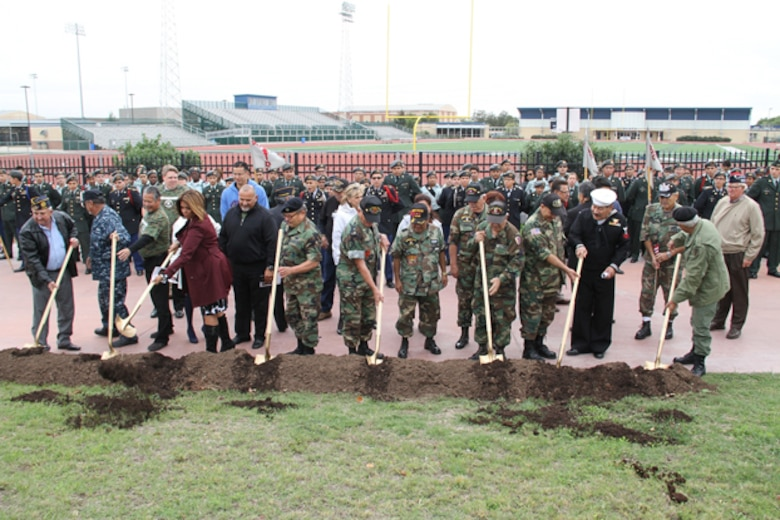 A groundbreaking ceremony was held at South San Antonio High School, Nov. 11, 2014, for a veteran's memorial that will be erected on the campus later next year. The memorial is meant to commemorate native San Antonio veterans, from across the military services, who have lost their lives serving their country. (Courtesy Photo)