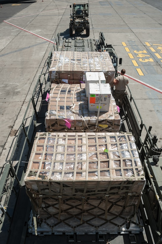 Aerial porters from the Kentucky Air National Guard's 123rd Contingency Response Group offload humanitarian cargo from a U.S. Air Force KC-10 aircraft at Léopold Sédar Senghor International Airport in Dakar, Senegal, Nov. 12, 2014. The Kentucky Airmen will stage the cargo in Senegal before transloading it to U.S. Air Force C-130J aircraft for delivery into Monrovia, Liberia, in support of Operation United Assistance, the U.S. Agency for International Development-led, whole-of-government effort to contain the Ebola virus outbreak in West Africa. (U.S. Air National Guard photo by Maj. Dale Greer)