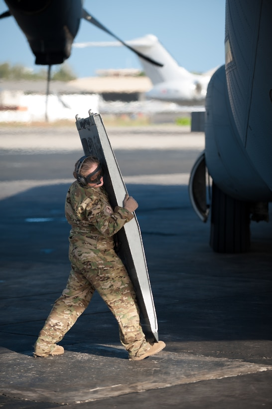 U.S. Air Force Staff Sgt. Kassondra Cline, a loadmaster for the 787th Air Expeditionary Squadron, prepares to position a loading ramp on a U.S. Air Force C-130J aircraft at Léopold Sédar Senghor International Airport in Dakar, Senegal, Nov. 11, 2014. The aircraft and crew, from Dyess Air Force Base Texas, are deployed to Senegal to fly humanitarian aid and troop-support equipment into Monrovia, Liberia, in support of Operation United Assistance, the U.S. Agency for International Development-led, whole-of-government effort to contain the Ebola virus outbreak in West Africa. (U.S. Air National Guard photo by Maj. Dale Greer)