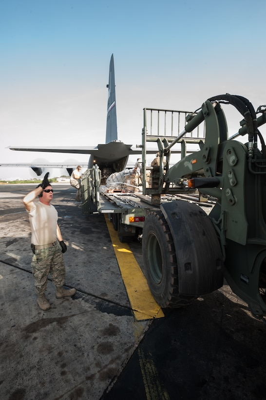 U.S. Air Force Tech. Sgt. Ryan McNary, an aerial porter from the Kentucky Air National Guard's 123rd Contingency Response Group, directs humanitarian cargo onto a U.S. Air Force C-130J aircraft during an engines-running on-load at Léopold Sédar Senghor International Airport in Dakar, Senegal, Nov. 10, 2014. The aircraft and crew are deployed to Senegal from Dyess Air Force Base, Texas, as part of the 787th Air Expeditionary Squadron and will fly the cargo into Monrovia, Liberia, in support of Operation United Assistance, the U.S. Agency for International Development-led, whole-of-government effort to contain the Ebola virus outbreak in West Africa. (U.S. Air National Guard photo by Maj. Dale Greer)