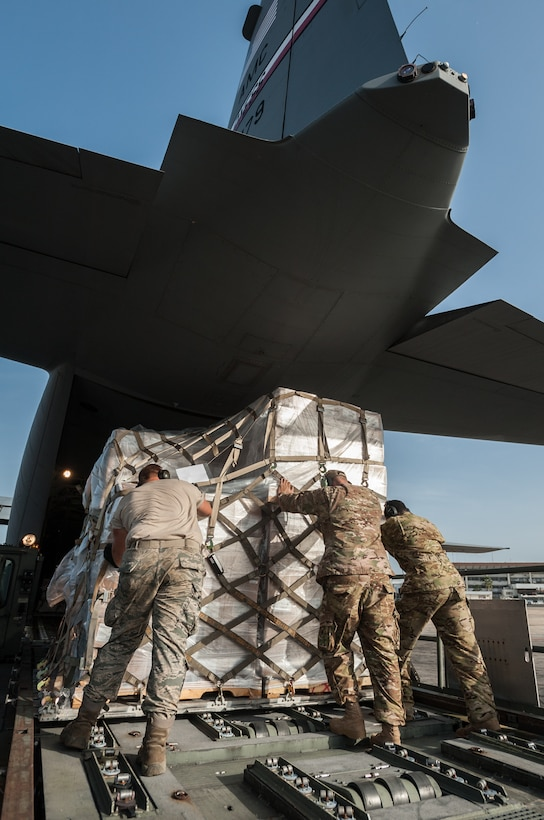 An aerial porter from the Kentucky Air National Guard's 123rd Contingency Response Group and loadmasters from the 317th Airlift Group at Dyess Air Force Base, Texas, load humanitarian cargo onto a U.S. Air Force C-130J aircraft at Léopold Sédar Senghor International Airport in Dakar, Senegal, Nov. 10, 2014. The aircraft and crew, all from Dyess, are deployed to Senegal as part of the 787th Air Expeditionary Squadron and will fly the cargo into Monrovia, Liberia, in support of Operation United Assistance, the U.S. Agency for International Development-led, whole-of-government effort to contain the Ebola virus outbreak in West Africa. (U.S. Air National Guard photo by Maj. Dale Greer)