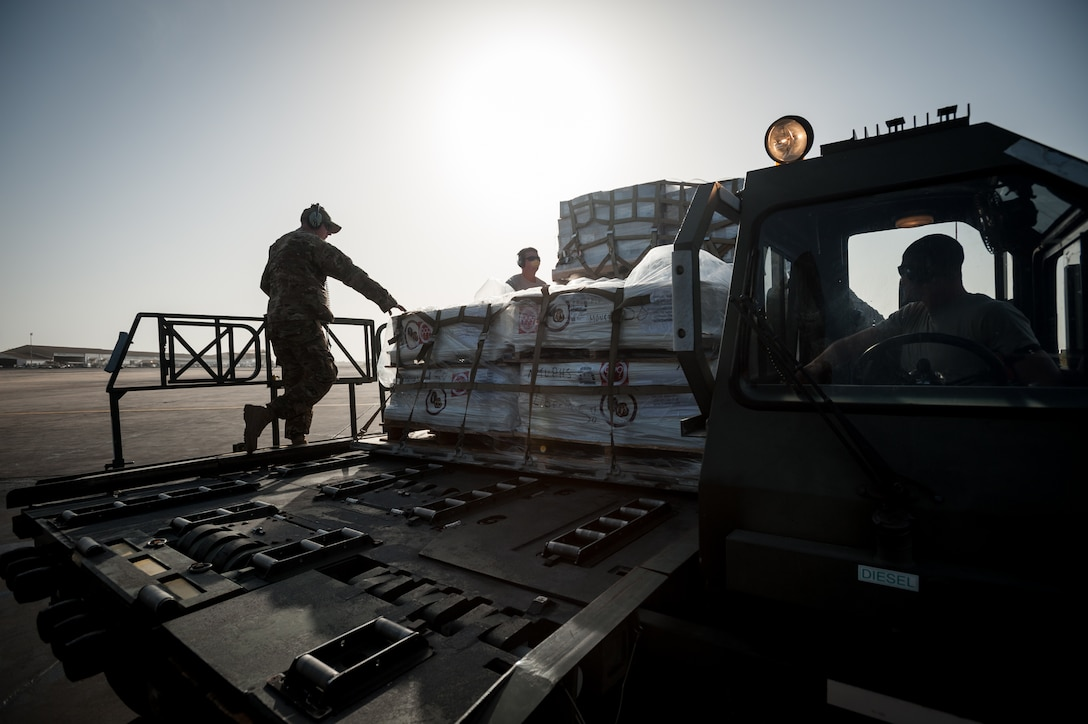 Aerial porters from the Kentucky Air National Guard's 123rd Contingency Response Group and a loadmaster from the 317th Airlift Group at Dyess Air Force Base, Texas, load humanitarian cargo onto a U.S. Air Force C-130J aircraft at Léopold Sédar Senghor International Airport in Dakar, Senegal, Nov. 10, 2014. The aircraft and crew, all from Dyess, are deployed to Senegal as part of the 787th Air Expeditionary Squadron and will fly the cargo into Monrovia, Liberia, in support of Operation United Assistance, the U.S. Agency for International Development-led, whole-of-government effort to contain the Ebola virus outbreak in West Africa. (U.S. Air National Guard photo by Maj. Dale Greer)
