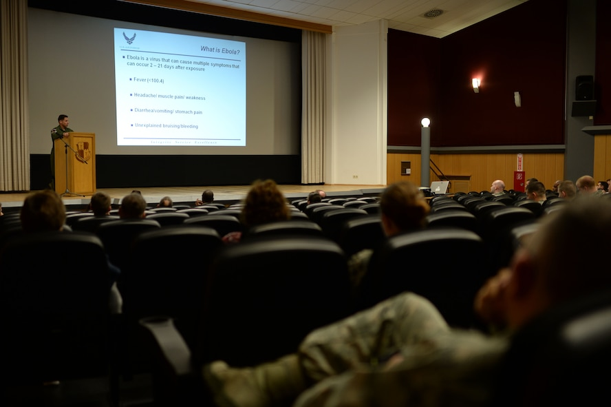 U.S. Air Force Lt. Col. Dan Murray, 52nd Aerospace Medicine Squadron commander and 52nd Fighter Wing public health emergency officer, speaks at a wing information forum Nov. 13, 2014, at the base theater regarding the Ebola virus disease, or EVD, and preventative actions the Airmen of Spangdahlem Air Base, Germany, are taking. Murray explained the symptoms of EVD and how someone can avoid contracting the virus. (U.S. Air Force photo by Staff Sgt. Daryl Knee/Released)