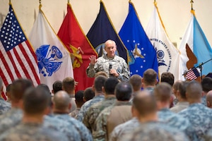 U.S. Army Gen. Martin E. Dempsey, chairman of the Joint Chiefs of Staff, talks with U.S. service members during a town hall meeting in Baghdad, Iraq, Nov. 15, 2014. Dempsey addressed questions that ranged from Iraq's long-term ability to resist threats to the U.S. rebalance in the Asia-Pacific. DoD photo by D. Myles Cullen
