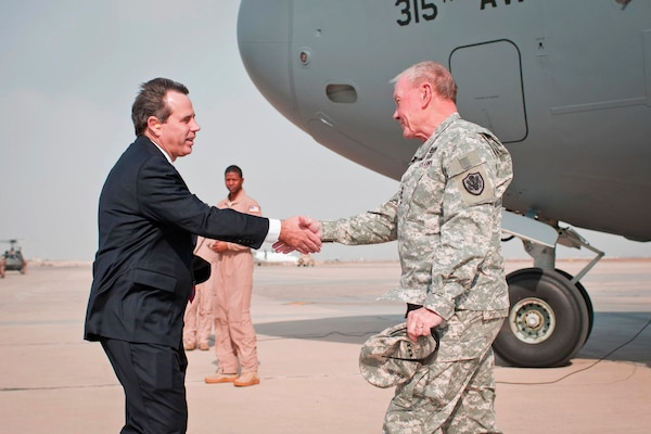U.S. Ambassador to Iraq Stuart E. Jones greets U.S. Army Gen. Martin E. Dempsey, chairman of the Joint Chiefs of Staff, as he arrives in Baghdad, Nov. 15, 2014. Dempsey is visiting deployed U.S. service members, civilians and Iraqi leaders. DoD photo by D. Myles Cullen