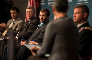 Medal of Honor recipient former Army Staff Sgt. Salvatore A. Giunta, center, takes part in a panel discussion at the Reagan National Defense Forum at the Ronald Reagan Presidential Library in Simi Valley, Calif., Nov. 15, 2014. DoD photo by Kevin O'Brien