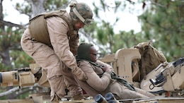 Marines with Tank Platoon, Company B, Ground Combat Element Integrated Task Force, conduct a casualty evacuation drill on the outside trails of Landing Zone Hawk at Marine Corps Base Camp Lejeune, North Carolina, Nov. 13, 2014. From October 2014 to July 2015, the GCEITF will conduct individual and collective level skills training in designated ground combat arms occupational specialties in order to facilitate the standards based assessment of the physical performance of Marines in a simulated operating environment performing specific ground combat arms tasks.