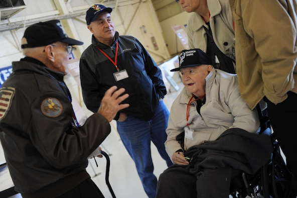 Don Miller, left, and Frank Epperson, seated, reminisce about their times as members of the 75th Fighter Squadron during World War II during a reunion Nov. 14, 2014, at Moody Air Force Base, Ga. Their unit, the 75th FS, is currently located at Moody AFB and has linage to the historic Flying Tigers. (U.S. Air Force photo/Andrea Jenkins)