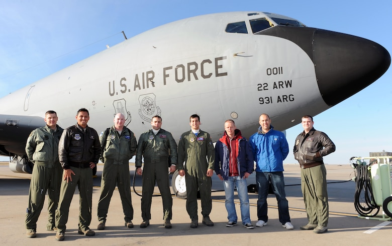 Aircrew members and two Dutch air traffic controllers pose for a photo, Nov. 14, at McConnell Air Force Base, Kan. The Dutchmen visited McConnell to familiarize themselves with air refueling and other aircraft maneuvers in order to improve communication and better assist U.S. forces. (U.S. Air Force photo/Airman 1st Class David Bernal Del Agua)