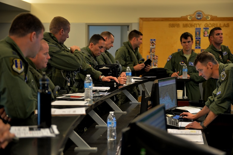 F-35 Lightning II and F-22 Raptor pilots attend a preflight briefing before an integrated training mission on Eglin Air Force Base, Florida, Nov. 6, 2014. The U.S. Air Force deployed four F-22 Raptors from Joint Base Langley-Eustis, Virginia, to Eglin Air Force Base, Florida, for the first operational integration training mission with the F-35A Lightning II assigned to the 33rd Fighter Wing. The purpose of the training was to improve integrated employment of fifth-generation assets and tactics. (U.S. Air Force photo/Master Sgt. Shane A. Cuomo)