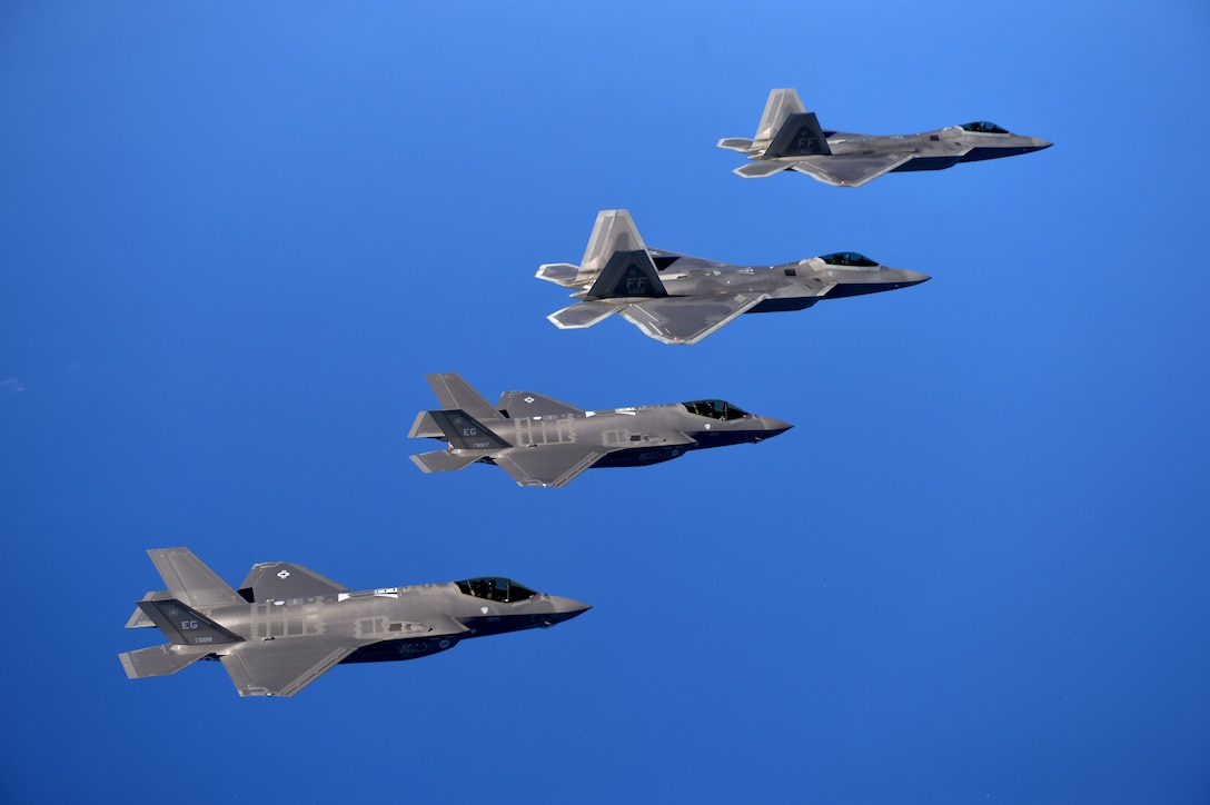 F-22 Raptors from the 94th Fighter Squadron, Joint Base Langley-Eustis, Virginia, and F-35A Lightning IIs from the 58th Fighter Squadron, Eglin Air Force Base, Florida, fly in formation after completing an integration training mission over the Eglin Training Range, Florida, Nov. 5, 2014. The purpose of the training was to improve integrated employment of fifth-generation assets and tactics. The F-35s and F-22s flew offensive counter air, defensive counter air and interdiction missions, maximizing effects by employing fifth-generation capabilities together. (U.S. Air Force photo/Master Sgt. Shane A. Cuomo)