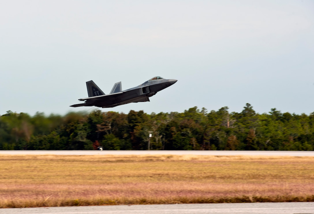 An F-22 Raptor takes off for an integrated training mission on Eglin Air Force Base, Florida, Nov. 5, 2014. The U.S. Air Force deployed four F-22A Raptors from Joint Base Langley-Eustis, Virginia, to Eglin Air Force Base, Florida, for the first operational integration training mission with the F-35A Lightning II assigned to the 33rd Fighter Wing. The purpose of the training was to improve integrated employment of fifth-generation assets and tactics. (U.S. Air Force photo/Staff Sgt. Marleah Robertson)
