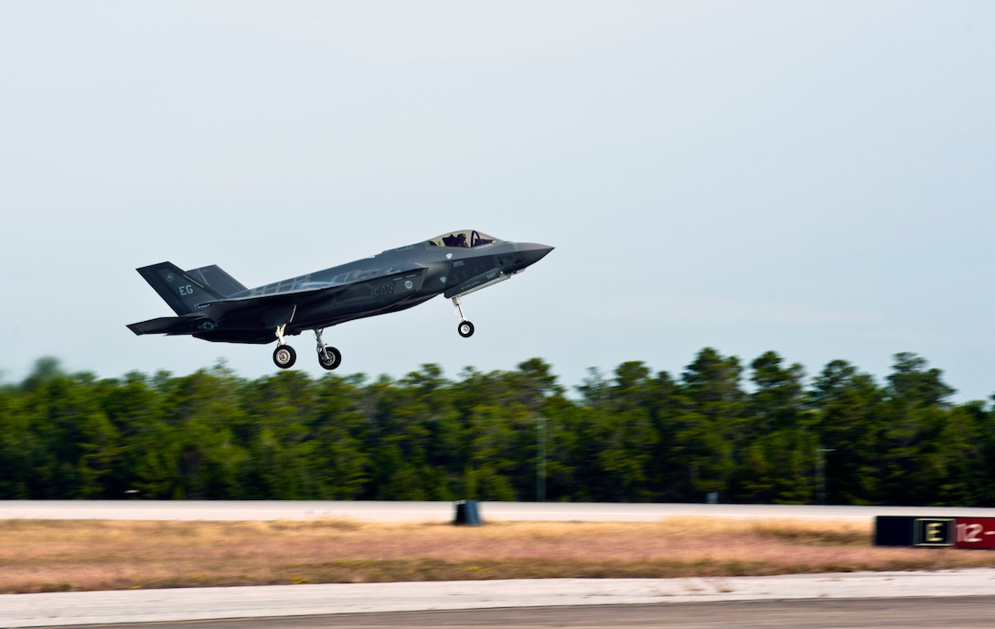 An F-35A Lightning II takes off for an integrated training mission on Eglin Air Force Base, Florida, Nov. 5, 2014. The U.S. Air Force deployed four F-22A Raptors from Joint Base Langley-Eustis, Virginia, to Eglin Air Force Base, Florida, for the first operational integration training mission with the F-35A Lightning II assigned to the 33rd Fighter Wing. The purpose of the training was to improve integrated employment of fifth-generation assets and tactics. (U.S. Air Force photo/Staff Sgt. Marleah Robertson)