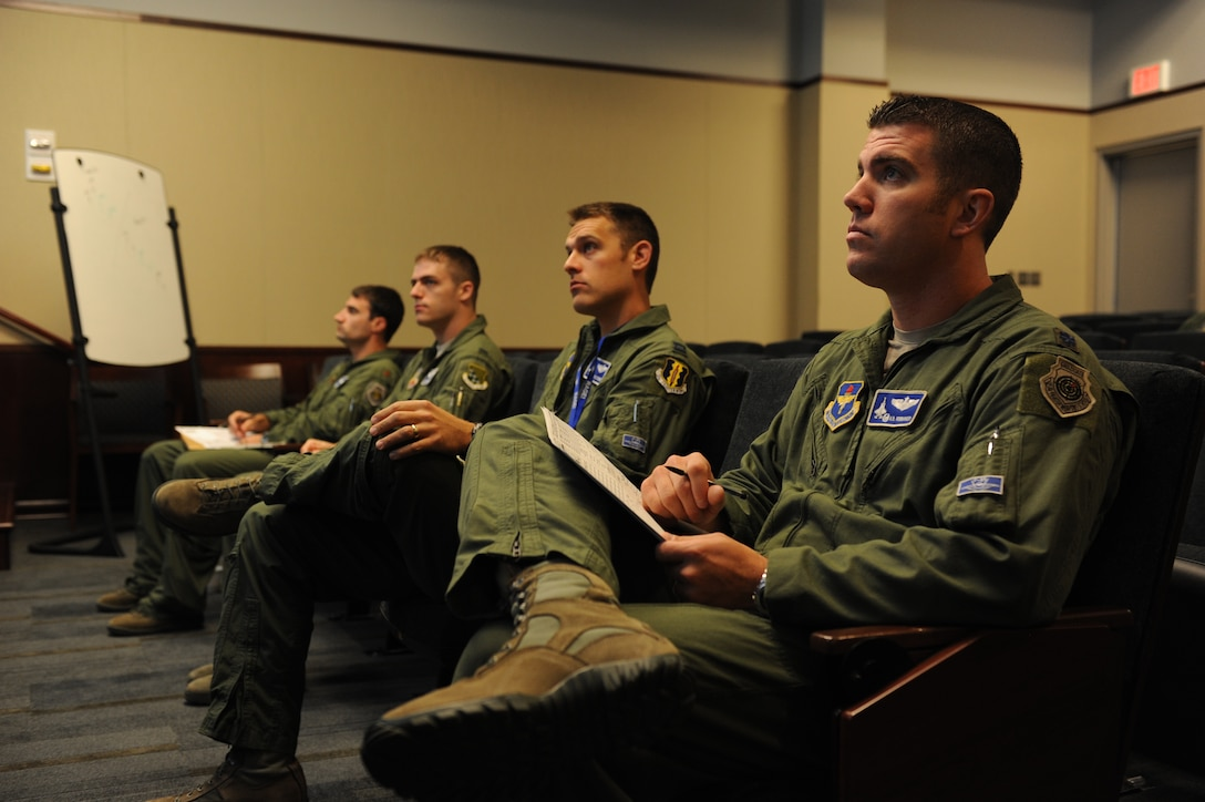 F-35A Lightning II and F-22 Raptor pilots listen to a preflight briefing before an integrated training mission on Eglin Air Force Base, Florida, Nov. 5, 2014. The F-35s and F-22s flew offensive counter air, defensive counter air and interdiction missions together, employing tactics to maximize their fifth-generation capabilities. (U.S. Air Force photo/Staff Sgt. Marleah Robertson)