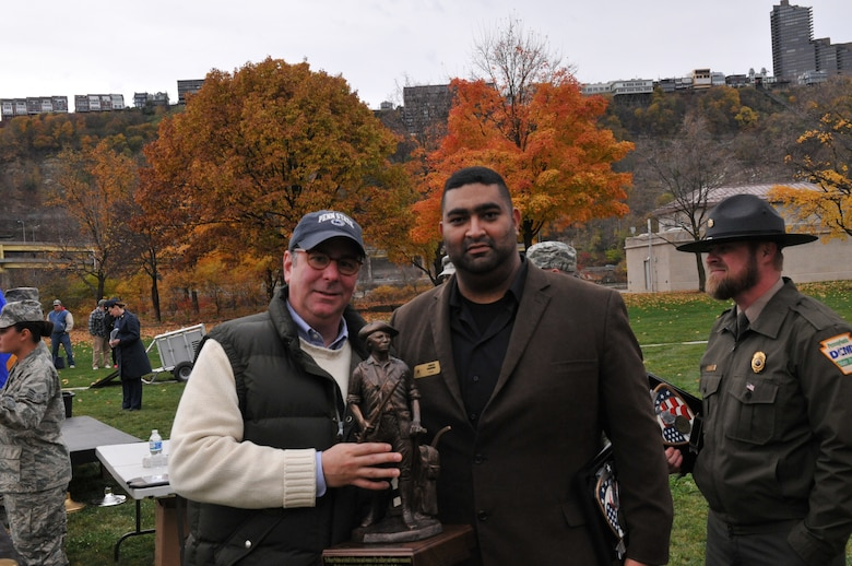 Pittsburgh Mayor Bill Peduto and Carlos Carmona from the Association of the United States Army pose for a photo at the Steel City Salutes the Troops, November 8, 2014.  The Pennsylvania National Guard joined with the Pennsylvania Department of Conservation of Natural Resources' Point State Park and the Association of the United States Army to organize Steel City Salutes the Troops.  The event is a celebration of the region's military history, community impact and continued relevance. (U.S. Air National Guard photo by Staff Sgt. Michael Fariss/ Released)